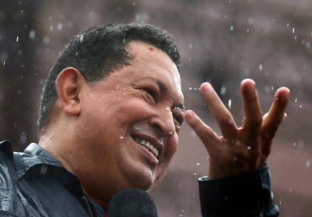 Venezuela's President and presidential candidate Hugo Chavez speaks in the rain during his closing campaign rally in Caracas October 4, 2012. REUTERS/Jorge Silva (VENEZUELA - Tags: POLITICS ELECTIONS)